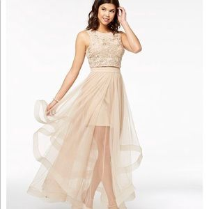 Beautiful prom dress. Worn once to a dinner party.